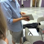 B.A.G. member holding a book – Book Arts Guild of Vermont Open Bindery – June 2012