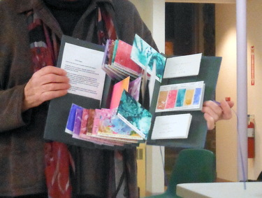 Nancy Stone sharing her handmade book of painted Yupo samples