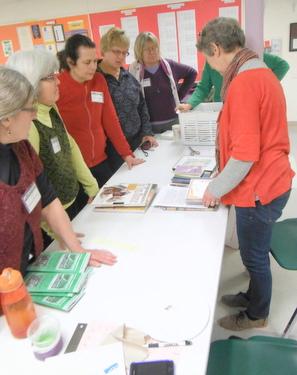 Marcia Vogler sharing her handmade postcards