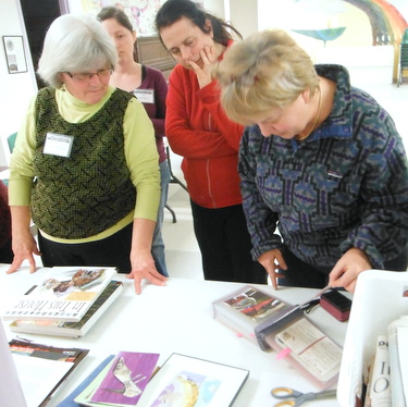 Book Arts Guild of VT members looking at Marcia Vogler's work