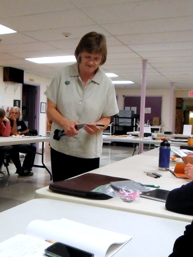 Carolyn Guest doing a cut paper demonstration