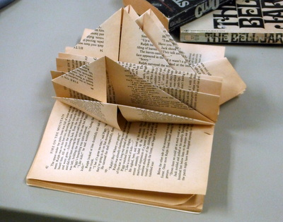 Folded altered book pages