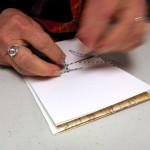 Sewing a handmade book