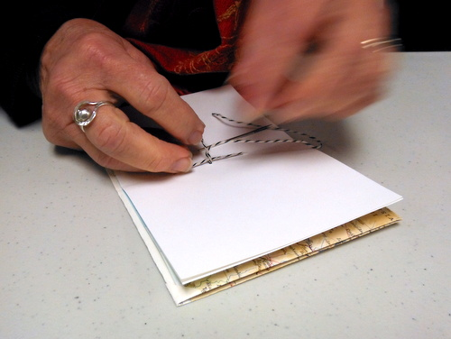 Sewing a handmade book