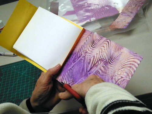 Person working on handmade book