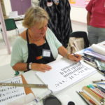 Penne Tompkins demonstrating calligraphy