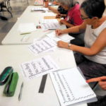 Book Arts Guild of Vermont members practicing calligraphy