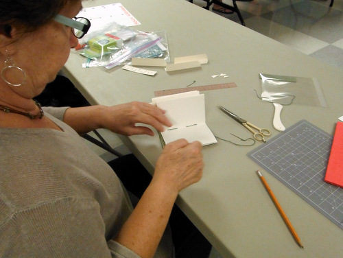 Book Arts Guild of Vermont member sewing a journal
