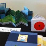 Work by Marcia Vogler on display at the Burlington Book Festival