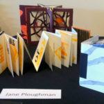 Work by Jane Ploughman on display at the Burlington Book Festival