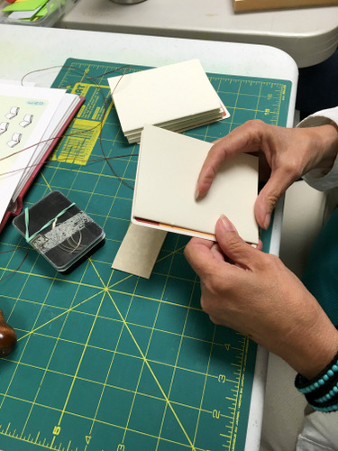 Book Arts Guild of Vermont member sewing a book