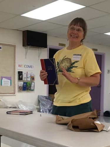 Marianna Holzer sharing her handbound books