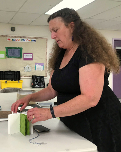 Jill Abilock showing one of her handbound books