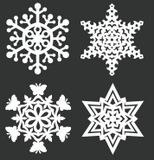 4 cut paper snowflakes