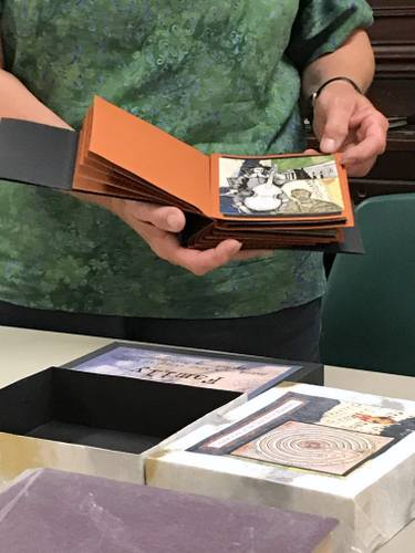 Person showing handmade book